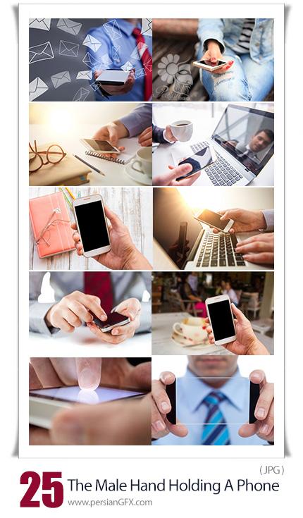 دانلود تصاویر با کیفیت موبایل، تبلت و لپ تاپ در دست مرد - The Male Hand Holding A Phone Against The Background Of The Table