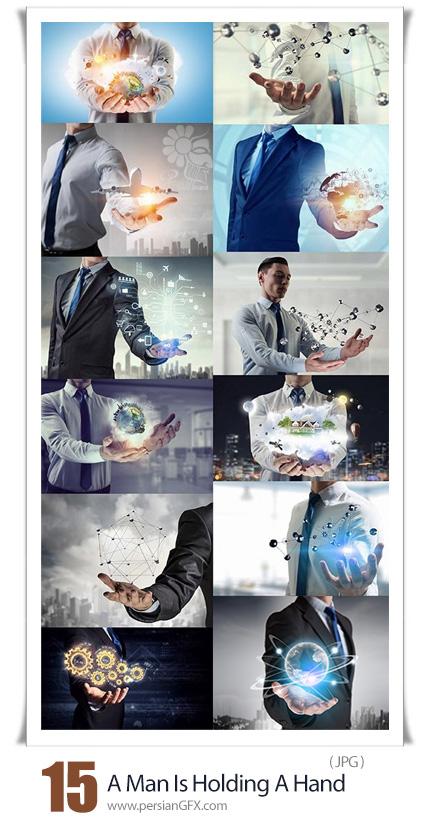 دانلود 15 عکس مفهومی تجاری - A Man Is Holding A Hand